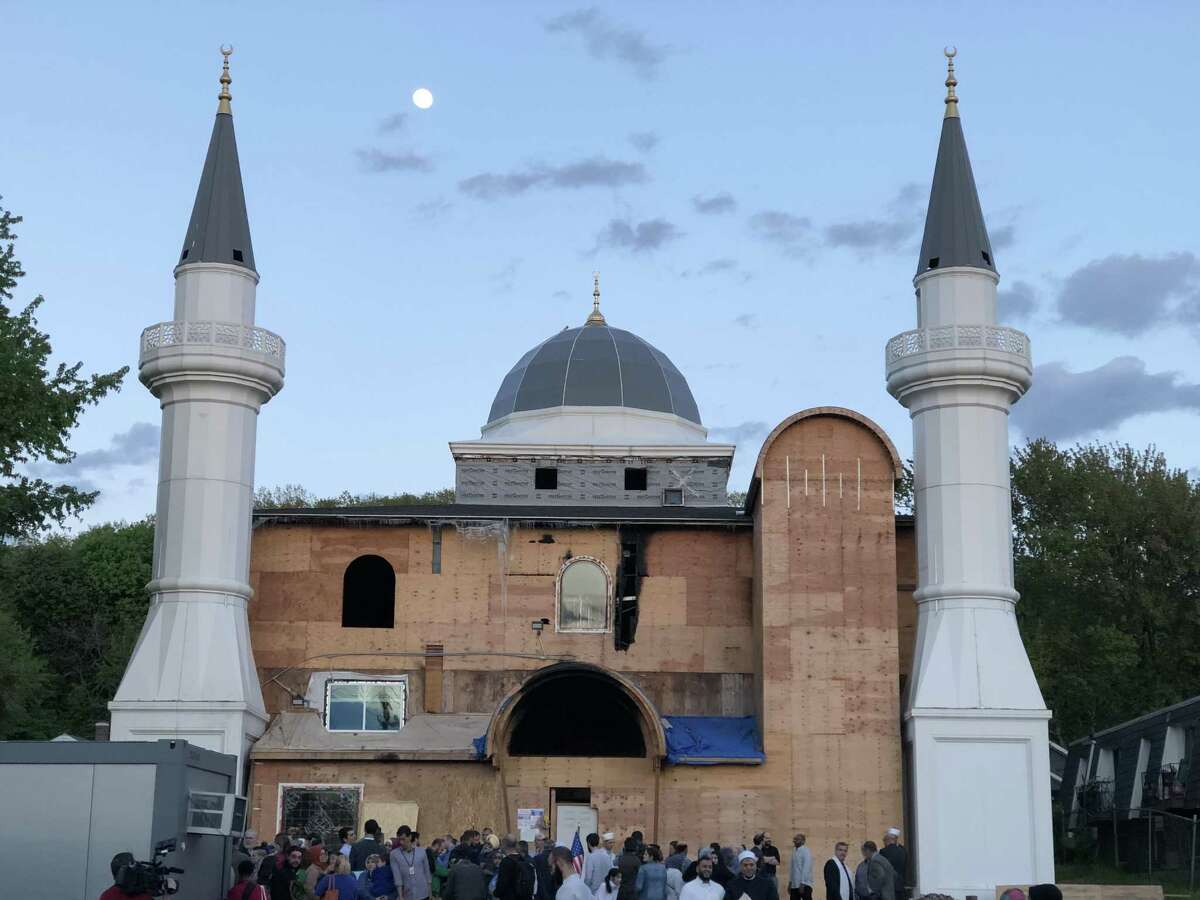 Residents gather Thursday at a vigil following a fire at the Diyanet Mosque of New Haven.