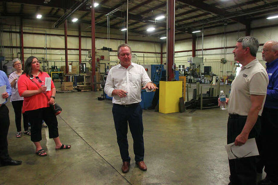 PRS Group President Jeff Williams (center) leads a tour of his business Thursday. Photo: Rosalind Essig | Journal-Courier