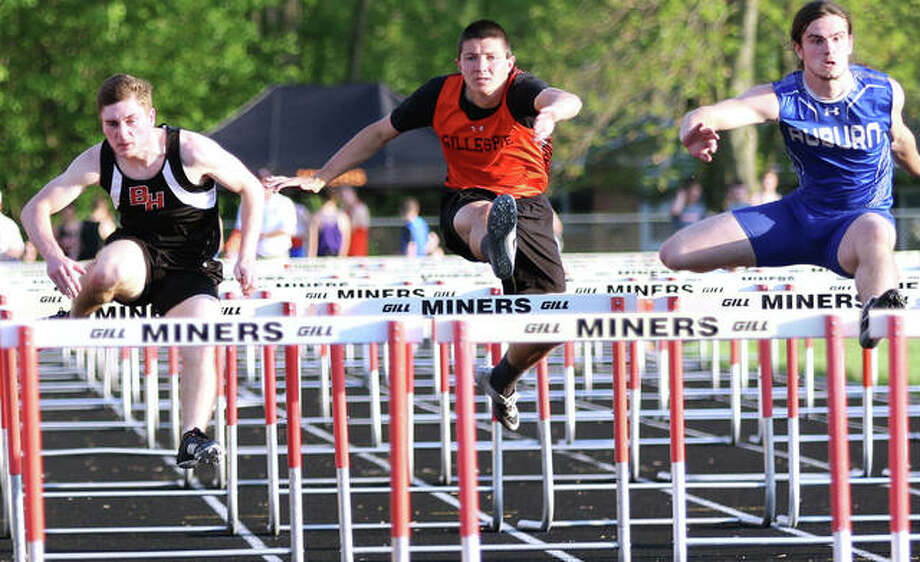 Bunker Hill's Trent Bertelsman (left) is first over the second-to-last hurdle ahead of Gillespie's Alex Ottersburg (middle) and Auiburn Joseph Derhake in the 110-meter high hurdles Thursday at the Gillespie Class 1A Sectional. Derhake finished second in the race, Bertelsman was third and Ottersburg was fourth. Derhake and Bertelsman qualified for state. Photo: Greg Shashack | The Telegraph