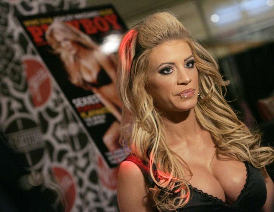 "PHOTOS: More of former WWE wrestler Ashley Massaro Ashley Massaro during Ashley Massaro Signs the April 2007 Issue of ""Playboy"" at Virgin Megastore in Times Square - March 8, 2007 at Virgin Megastore Times Square in New York City, New York, United States. (Photo by Jemal Countess/WireImage) Photo: Jemal Countess/WireImage"