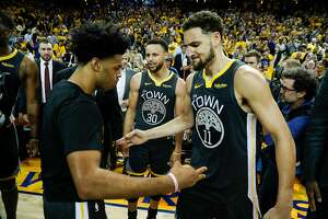 Golden State Warriors' Quinn Cook and Klay Thompson high five after the Warriors' 114 to 111 win in game 2 of the Western Conference Finals between the Golden State Warriors and the Portland Trail Blazers at Oracle Arena on Thursday, May 16, 2019 in Oakland, Calif.