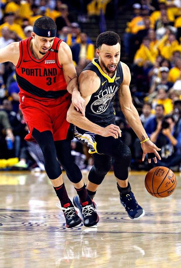 25800863a2f7 Golden State Warriors  Stephen Curry tries to get past Portland Trail  Blazers  Seth Curry