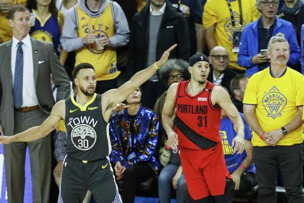 79622b20079 1of6Portland Trail Blazers  Seth Curry and Golden State Warriors  Stephen  Curry watch Curry s three-pointer in the fourth quarter during game 2 of  the ...