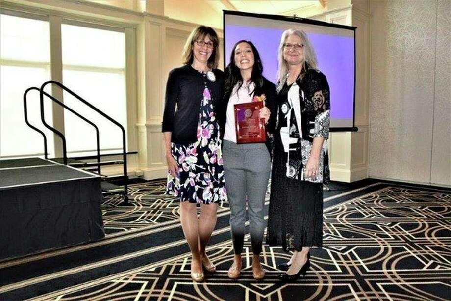 Spirit of Rotary award winnerKeri Kenney(center) was nominated byStephanie Leibfritz(left) and Bev Wenzel. (Photo provided)