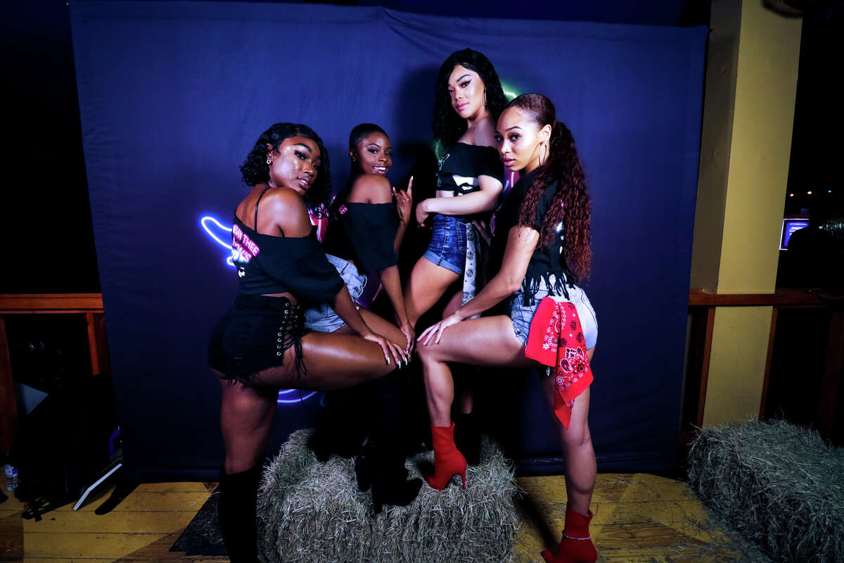 """Spotify hosted an album release party for Houston's own Megan Thee Stallion at Neon Boots Dancehall & Saloon on May 16th, 2019. The rapper arrived to the venue riding a white horse and wearing a white cowboy hat and chaps. The name of her new album is """"Fever"""". (Photo by Marco Torres/Freelance)"""
