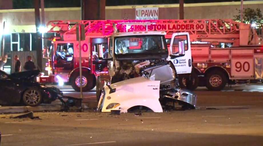 Police work to clear the scene of a fatal crash early Friday, May 17, at the Katy Freeway and Texas 6. The driver of the sedan hit the 18-wheeler in the intersection.>> Keep clicking through this gallery to see the deadliest highways in Texas. Photo: Metro Video
