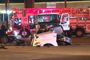 Police work to clear the scene of a fatal crash early Friday, May 17, at the Katy Freeway and Texas 6. The driver of the sedan hit the 18-wheeler in the intersection.