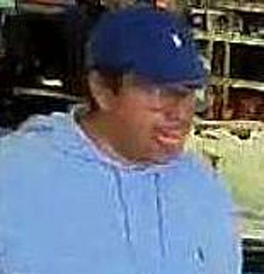 This man is one of two people who distracted a woman to steal a wallet from her pocketbook led to a shopping spree for electronics at Walmart. The theft happened on May 2, 2019 at a Wilton store. Photo: Witlton Police Photo