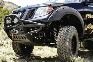The Nissan project truck's front end has touches like Baja Designs lights, ZEON winch and accessories, as well as a Hefty Fabworks front bumper and skid plates. (Nissan photo)