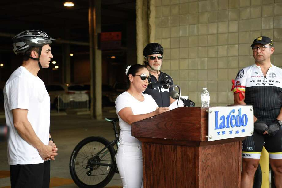 Poems are read in honor of cyclists killed on public roadways at the Ride of Silence in downtown Laredo on Wednesday night. Photo: Christian Alejandro Ocampo /Laredo Morning Times / Laredo Morning Times