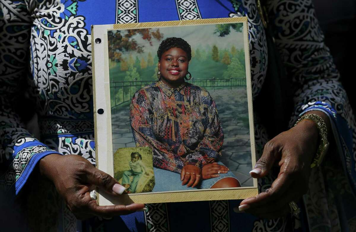 Antoinette Dorsey-James holds a picture of her sister Pamela Turner during a news conference outside the Harris County Civil Court in Houston on Thursday, May 16, 2019. Turner was killed during an altercation with a Baytown Police Department officer Monday night at The Brixton Apartments complex she lived at in Baytown, Texas. (Godofredo A Vasquez/Houston Chronicle via AP)