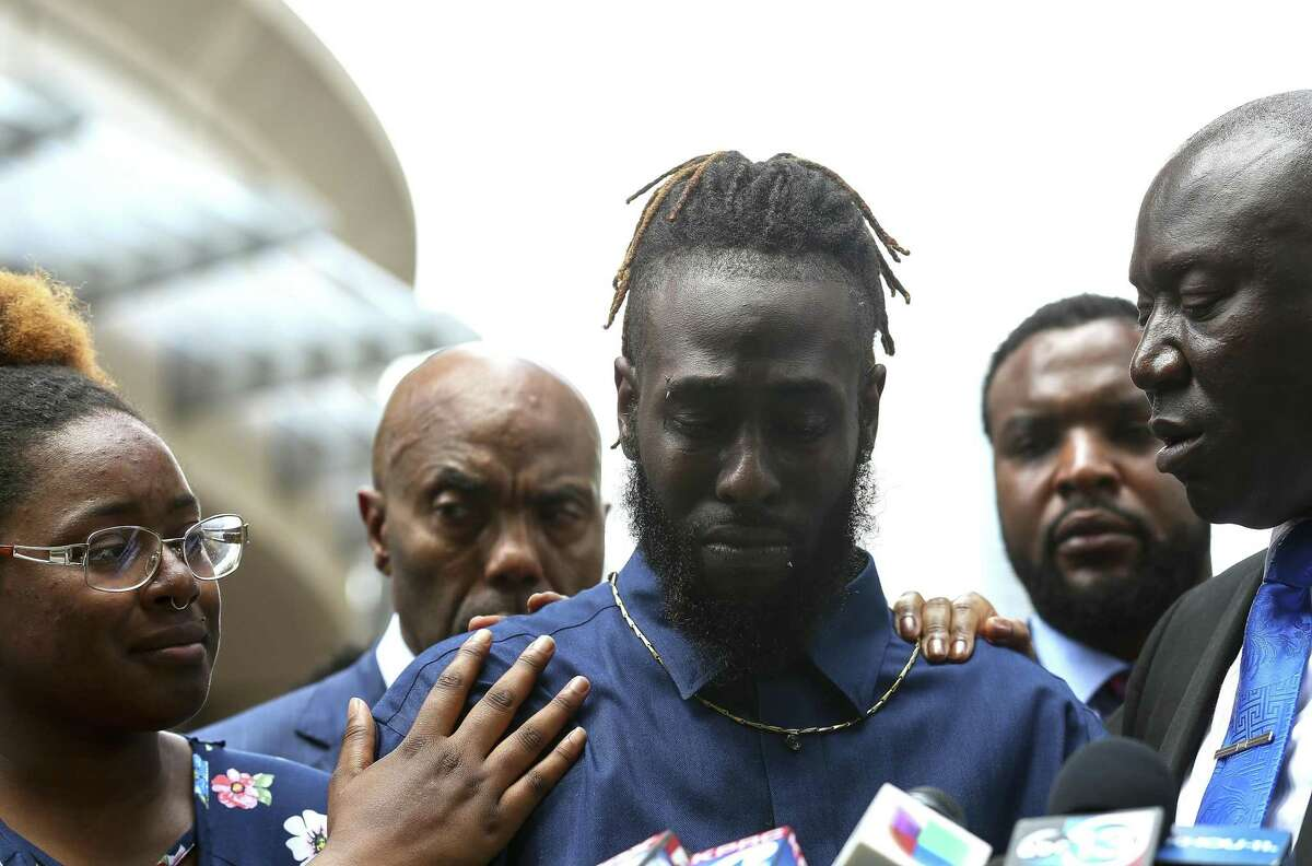 Cameron January, center, cries while talking to reporters about his late mother, Pamela Turner, during a news conference outside the Harris County Civil Court in Houston on Thursday, May 16, 2019. Turner was killed during an altercation with a Baytown Police Department officer Monday night at The Brixton Apartments complex she lived at in Baytown, Texas. (Godofredo A Vasquez/Houston Chronicle via AP)