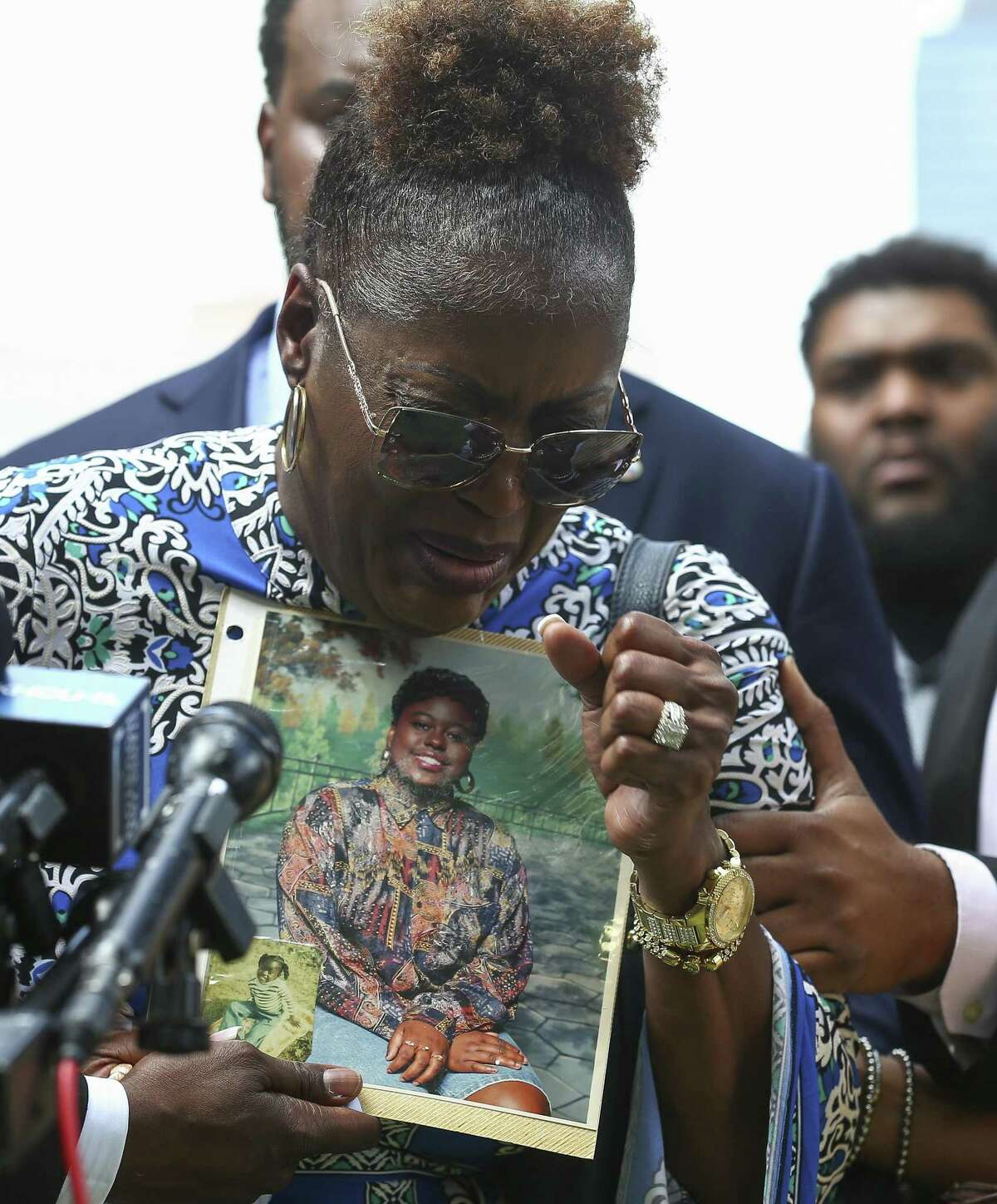 Antoinette Dorsey-James, center, cries while describing her late sister Pamela Turner during a press conference outside the Harris County Civil Court Thursday, May 16, 2019, in Houston. Turner was killed during an altercation with a Baytown Police Department officer Monday night at The Brixton Apartments complex she lived at in Baytown, Texas.