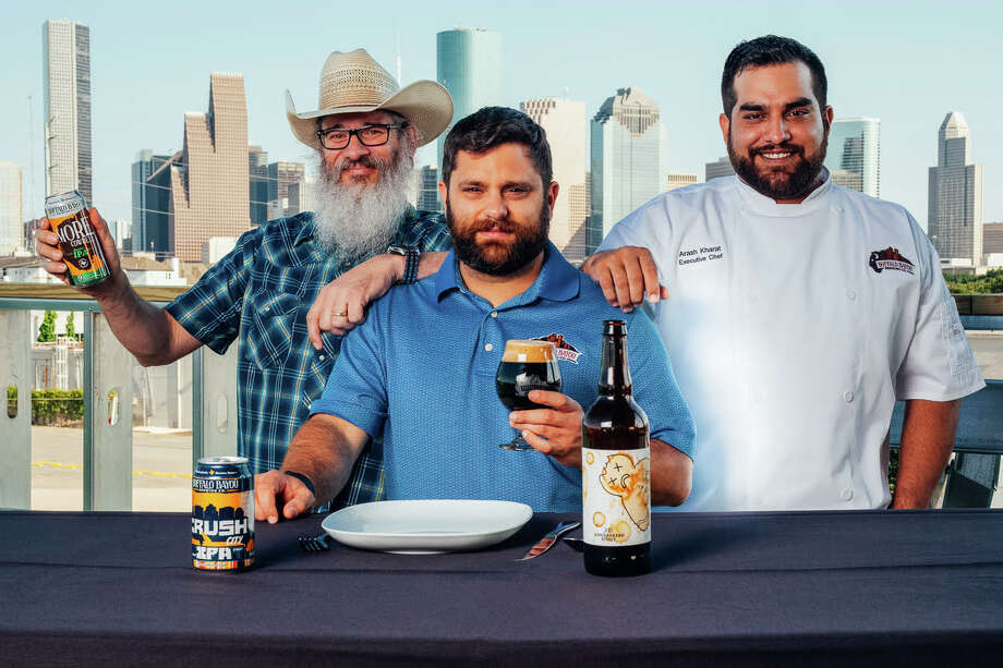 Buffalo Bayou Brewing Company's sales manager Troy Witherspoon and co-founder Rassul Zarinfar are welcoming chef Arash Kharat to the company. Kharat, formerly of Beaver's, is the brewery's new culinary director. Photo: Thomas Wilson / Copyright: Thomas A. WIlson - 2013