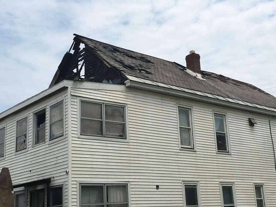 A fire at a home Friday morning on Webster Street in Schenectady gutted the structure where eight people and about a dozen animals lived. Photo: Paul Nelson / Times Union