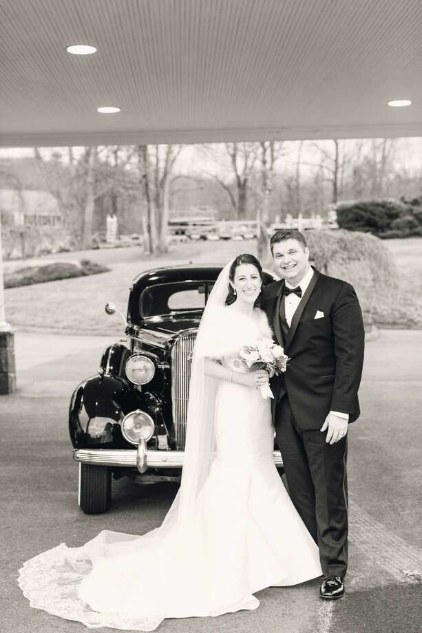 Alexa Angell Vacaro, left, and Jason Todd Bartlett, right, were married on Dec. 30, 2018 at St. Peter Roman Catholic Church in Danbury. Photo: / Contributed Photo