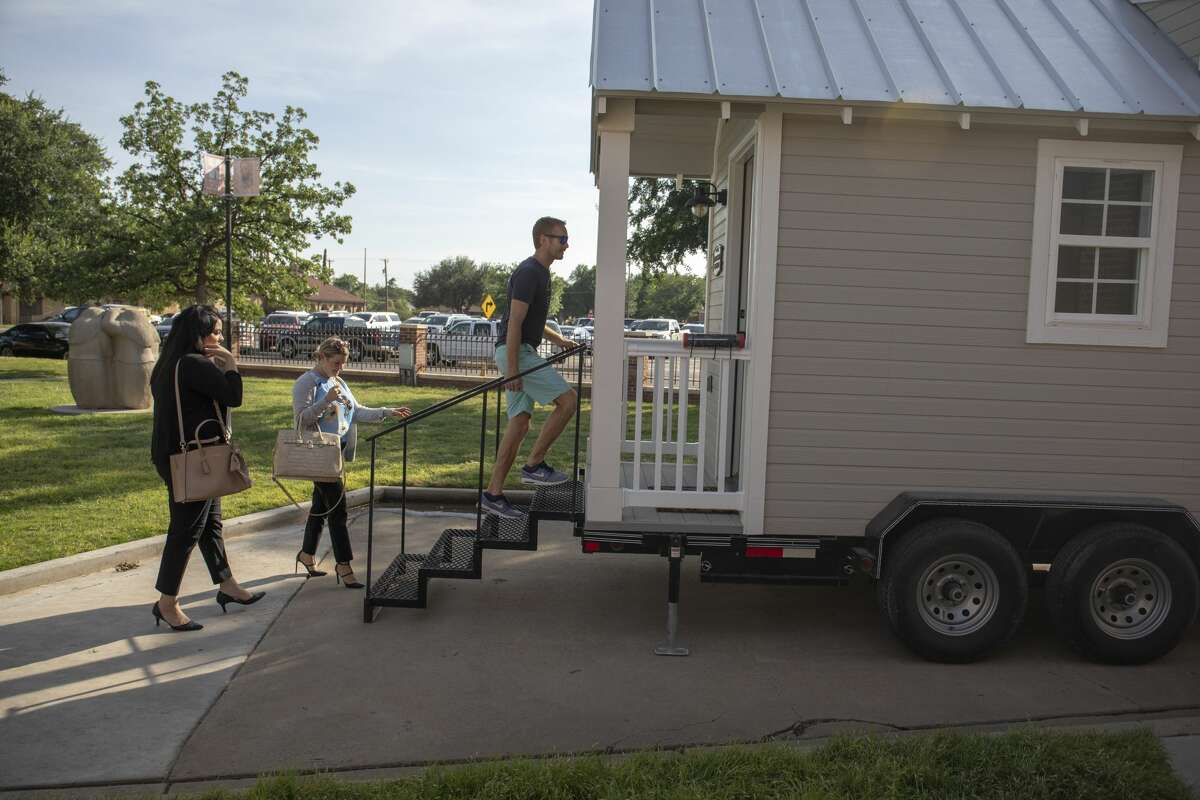 People look at a donated tiny home from Kahler Homes of during the West Texas Tiny Home competition on Thursday, May 16, 2019 at the Museum of the Southwest.