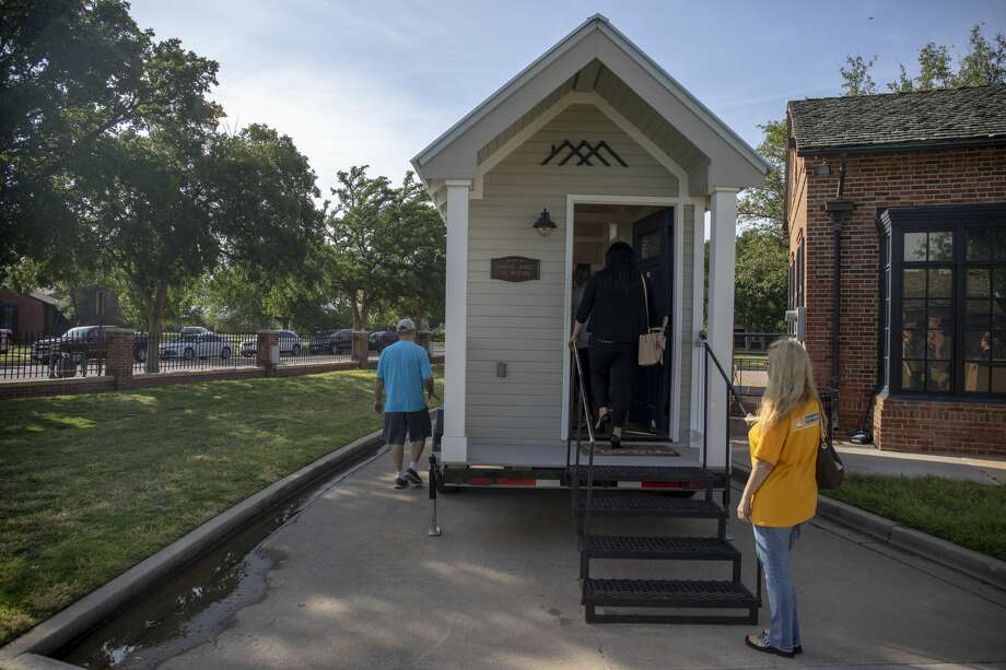 People look at a donated tiny home from Kahler Homes of during the West Texas Tiny Home competition on Thursday, May 16, 2019 at the Museum of the Southwest. Photo: Jacy Lewis/191 News
