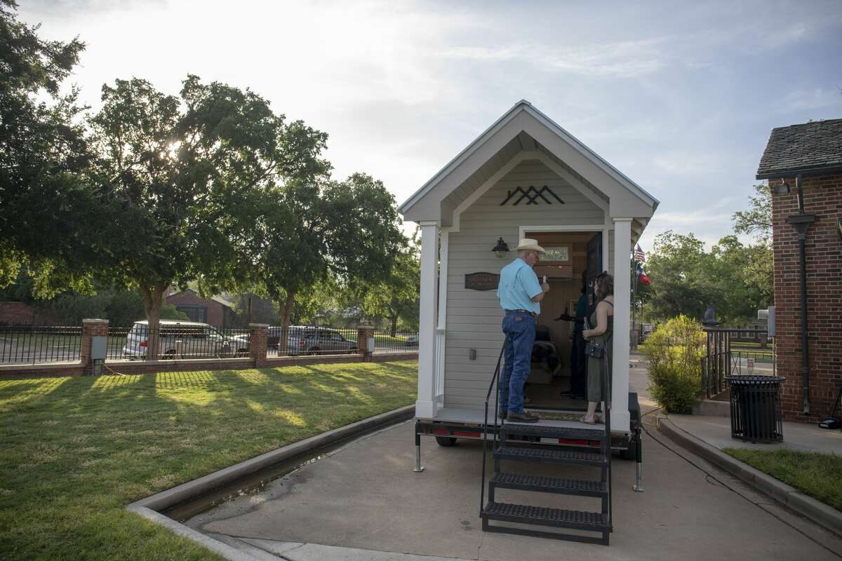 People look at a donated tiny home from Kahler Homes of Midland during the West Texas Tiny Home competition on Thursday, May 16, 2019 at the Museum of the Southwest.