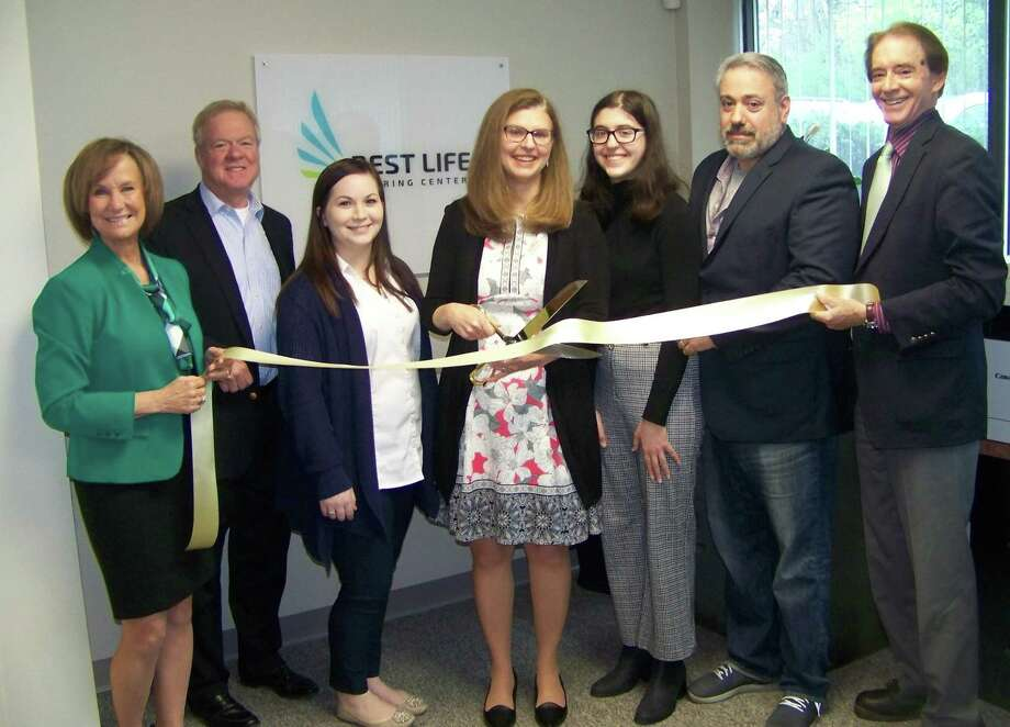 HEARING CENTER OPENS: From left, Quinnipiac Chamber of Commerce Executive Director Dee Prior-Nesti; Ulbrich Stainless Steels global HR director and chamber board Chairman Tom Curtin; patient coordinator Allyssa Cortright; audiologist and owner Dr. Jennifer Micacci and her daughter; Vincent Micacci; and Wallingford Mayor William Dickinson celebrate the grand opening of Best Life Hearing Center, 850 N. Main St. Ext., Building 1, Suite C1. The business offers personalized and professional hearing solutions Photo: Contributed Photo
