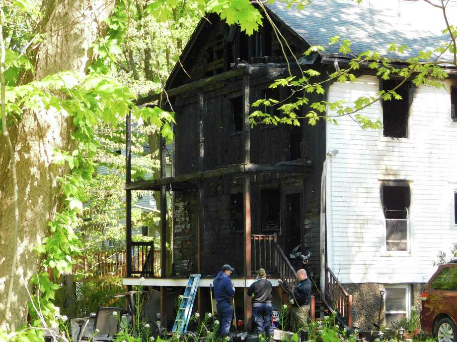 A fire destroyed the rear of a multi-family home at 101 Housatonic Ave. in New Milford on May 16, 2019. Photo: Kendra Baker / Hearst Connecticut Media