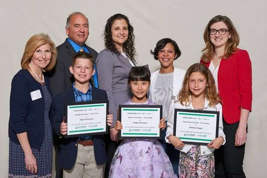 Middlefield student Addison Nappi, bottom row, far right, stands other third-grade eesmarts student contest award finalists and officials, left to right: Avon Town Councilwoman Heather McGuire, Ron Araujo, Eversource; Mary Sotos, DEEP deputy commissioner; state Rep. Tammy Exum; and Jane Lano, United Illuminating. She took second place in her category at the May 9 ceremony at the state Capitol. Photo: Contributed Photo