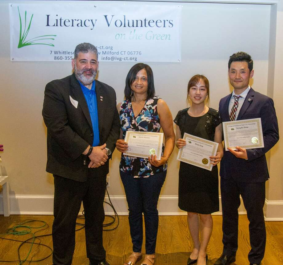 From left to right: New Milford Mayor Pete Bass, Navia Payano, Minju Jung and Seongho Hong. Photo: Contributed Photo /