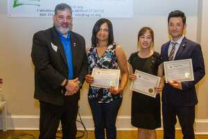 From left to right: New Milford Mayor Pete Bass, Navia Payano, Minju Jung and Seongho Hong.