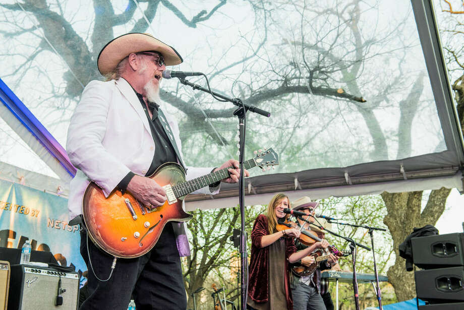 Lead guitarist and vocalist Ray Benson, left, fiddle player and vocalist Katie Shore and fiddle and mandolin player and vocalist Dennis Ludiker of Asleep At The Wheel performing in Austin. The band comes to Midland to headline Basin PBS' first block party. Photo: Jim Bennett/Wireimage