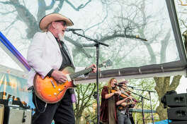 Lead guitarist and vocalist Ray Benson, left, fiddle player and vocalist Katie Shore and fiddle and mandolin player and vocalist Dennis Ludiker of Asleep At The Wheel performing in Austin. The band comes to Midland to headline Basin PBS' first block party.