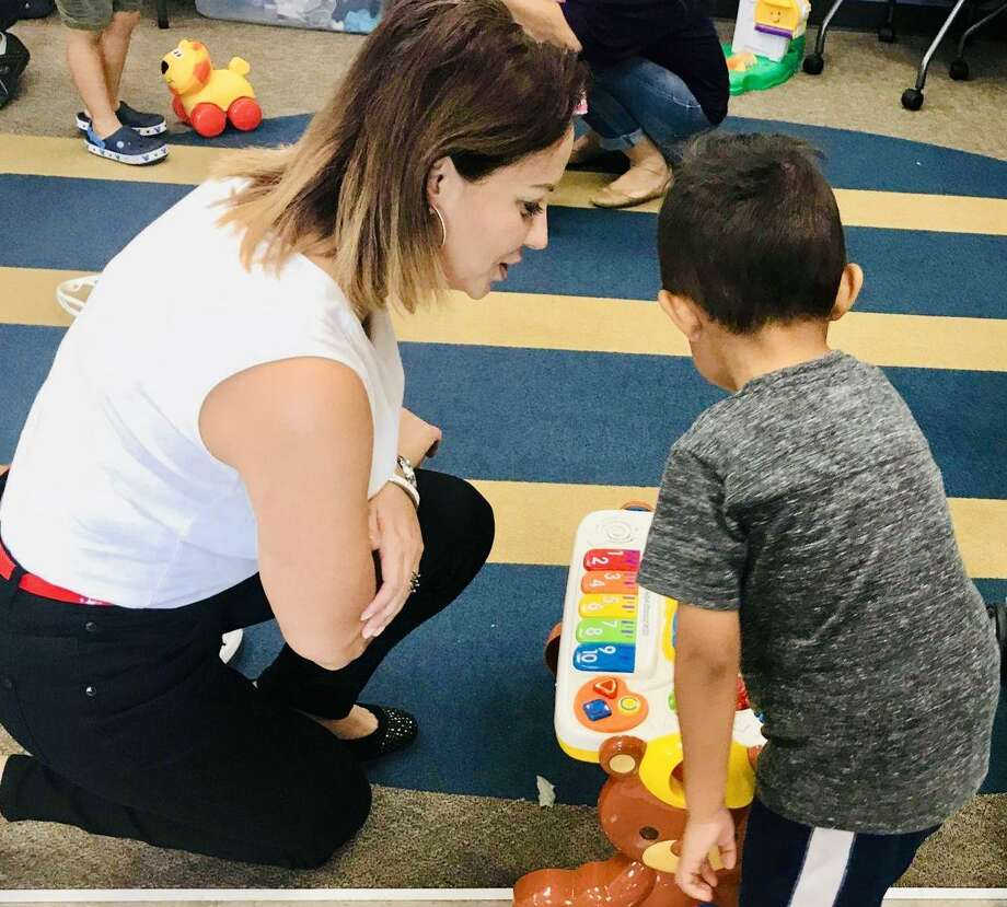Arcie Valdez, Communities In Schools of Houston (CIS) student support specialist at Wildcat Way Pre-K School in Spring Branch ISD, distributed donated toys, clothing and school supplies to her students and their families immediately after Hurricane Harvey. CIS says many children continue to suffer from mental and emotional trauma as a result of the storm. Photo: Communities In Schools Of Houston