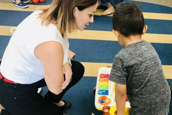 Arcie Valdez, Communities In Schools of Houston (CIS) student support specialist at Wildcat Way Pre-K School in Spring Branch ISD, distributed donated toys, clothing and school supplies to her students and their families immediately after Hurricane Harvey. CIS says many children continue to suffer from mental and emotional trauma as a result of the storm.