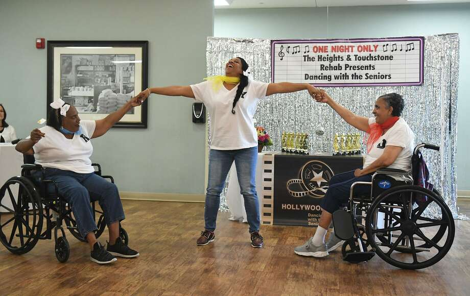 "Yvonee Henderson, center, Director of First Impressions, leads dance partners Rosie Shaffer, left, and Dora Duncklee in their performance to the Beatles ""Twist N' Shout"" during the Dancing with the Seniors competition at The Heights of North Houston nirsing facility on May 15, 2019. Photo: Jerry Baker, Houston Chronicle / Contributor / Houston Chronicle"