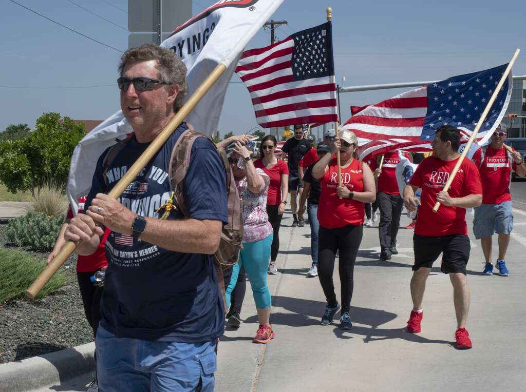 <p>David Lindsey, a Dallas fire fighter, and other team members from Carry the Load West Coast Team were joined in Midland by Pioneer employees 05/17/19 to help walk and raise awareness and funds honoring and</p>