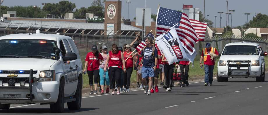 Team members from Carry the Load West Coast Team were joined in Midland by Pioneer employees 05/17/19 to help walk and raise awareness and funds honoring and celebrating military and first responders.  Tim Fischer/Reporter-Telegram Photo: Tim Fischer/Midland Reporter-Telegram