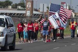 Team members from Carry the Load West Coast Team were joined in Midland by Pioneer employees 05/17/19 to help walk and raise awareness and funds honoring and celebrating military and first responders.  Tim Fischer/Reporter-Telegram