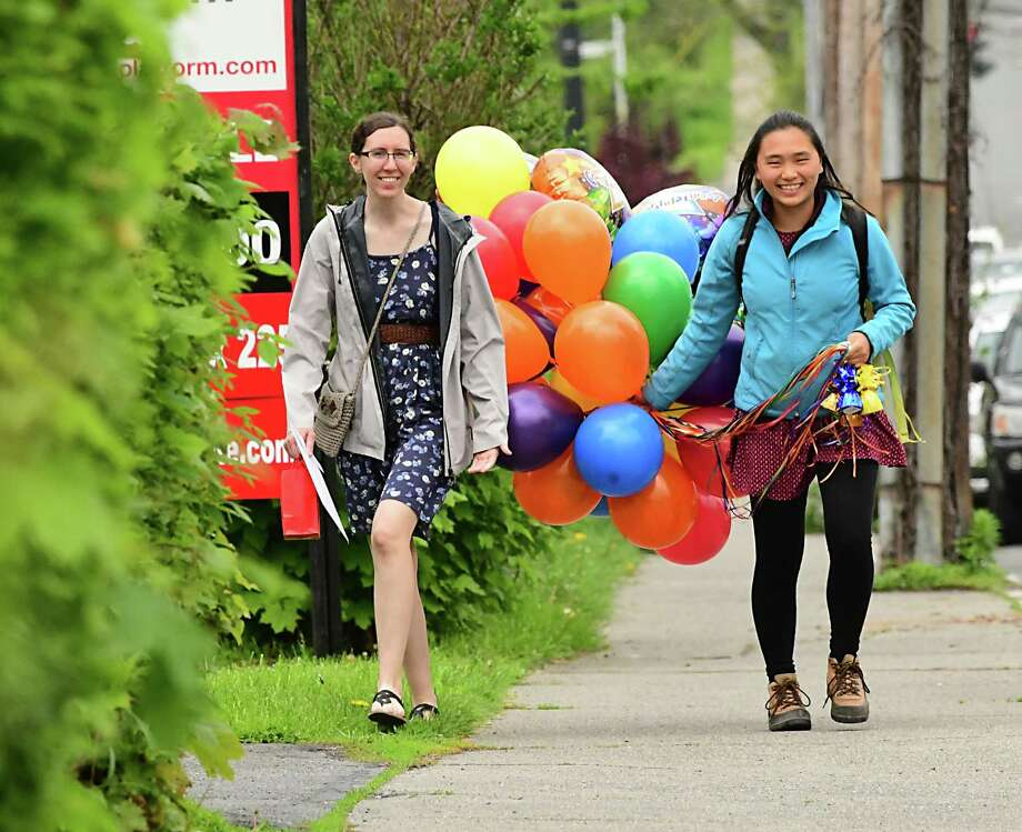 Rensselaer Polytechnic Institute students Wendy Tully-Gustafson, left, and Marisa Lee walk up 15th St. with a bunch of balloons they received at a luncheon a day before their commencement ceremony on Friday, May 17, 2019 in Troy, N.Y. (Lori Van Buren/Times Union) Photo: Lori Van Buren, Albany Times Union