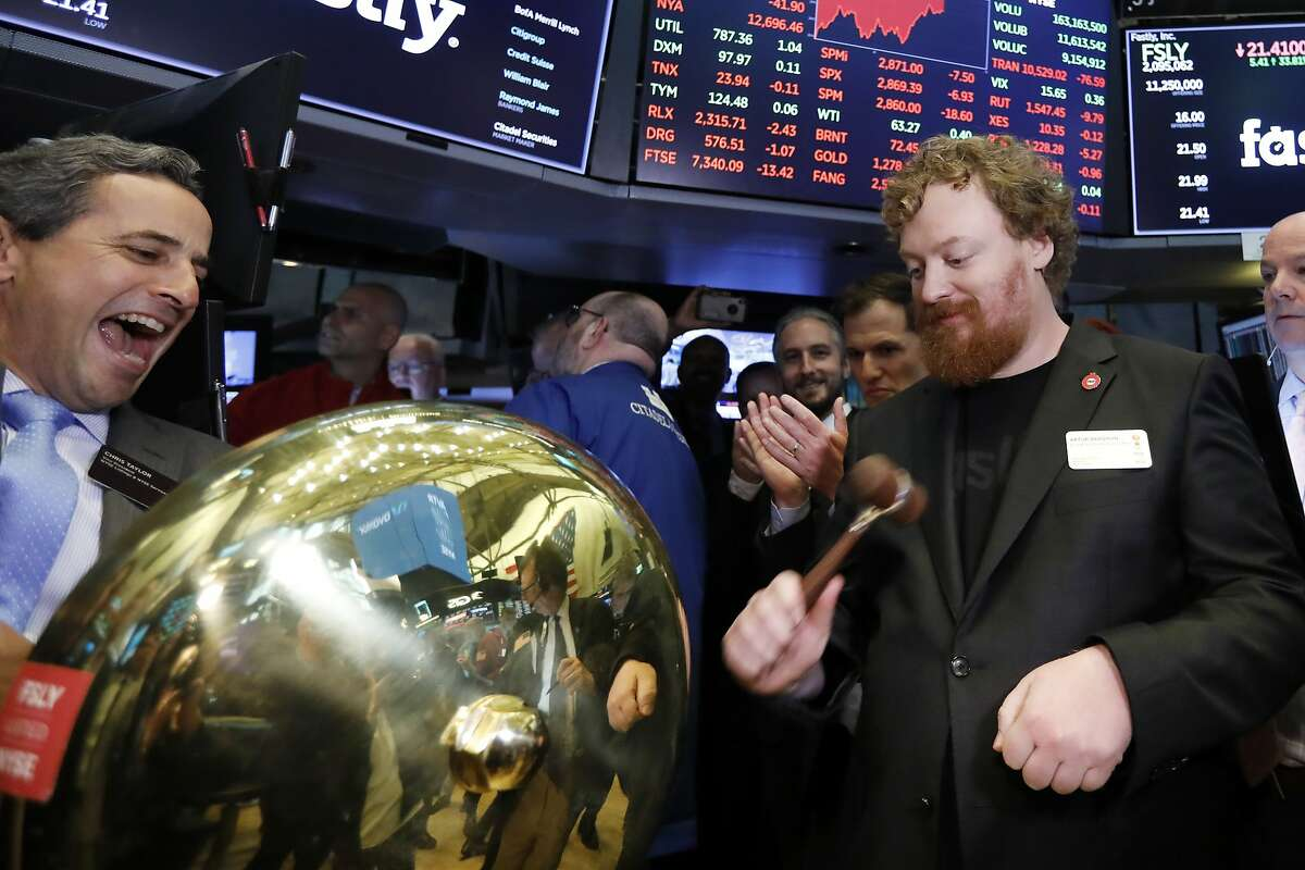 Fastly Founder & CEO Arthur Bergman, right, rings a ceremonial bell on the floor of the New York Stock Exchange as his company's IPO begins trading, Friday, May 17, 2019. (AP Photo/Richard Drew)