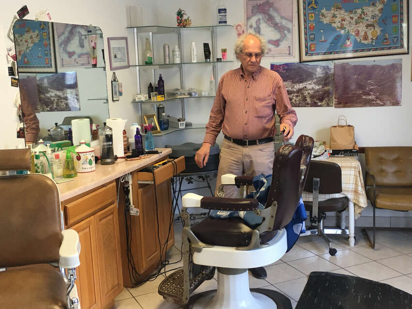 Antonino Ferrara pauses inside his barber shop in Schenectady to talk about his son, Davide Ferrara, and his frustration that police in Saratoga Springs have not made an arrest in a May 2, 2019, attack that left his son in a coma at Albany Medical Center.