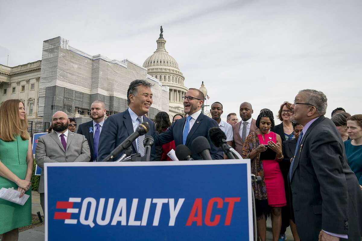 """Rep. Mark Takano, D-Calif., left, is greeted by Chad Griffin, president of the Human Rights Campaign, as they and other advocates for LGBTQ rights rally before a vote in the House on the """"Equality Act"""" in 2019. A new vote on the bill is expected this week."""