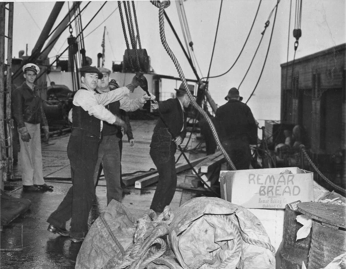 San Francisco longshoremen are back at work after a strike , January 3, 1940 Longshoremen are shown here rigging lines before loading the freighter Associated Press photo