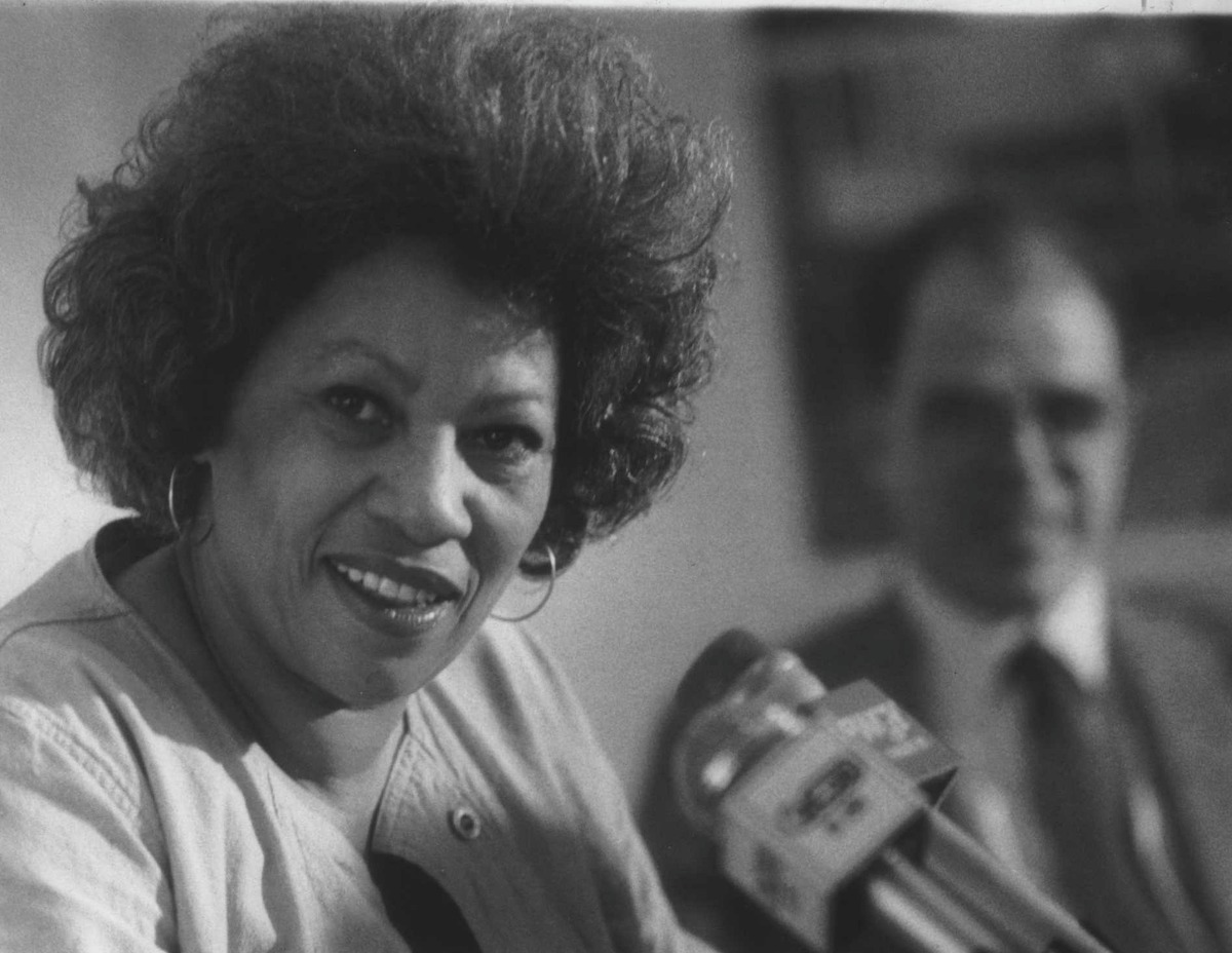 State University of New York, Albany Undated (SUNYA) - Toni Morrison at press conference with William Kennedy in back. September 13, 1984 (Fred McKinney/Times Union Archive)