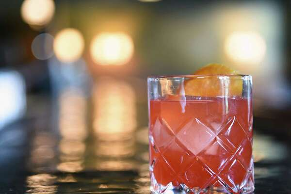 The Berkshire cocktail which consists of Taconic bourbon, amaro nonino, campari and lemon on Thursday, May 9, 2019 at the Stewart House in Athens, NY. (Phoebe Sheehan/Times Union)