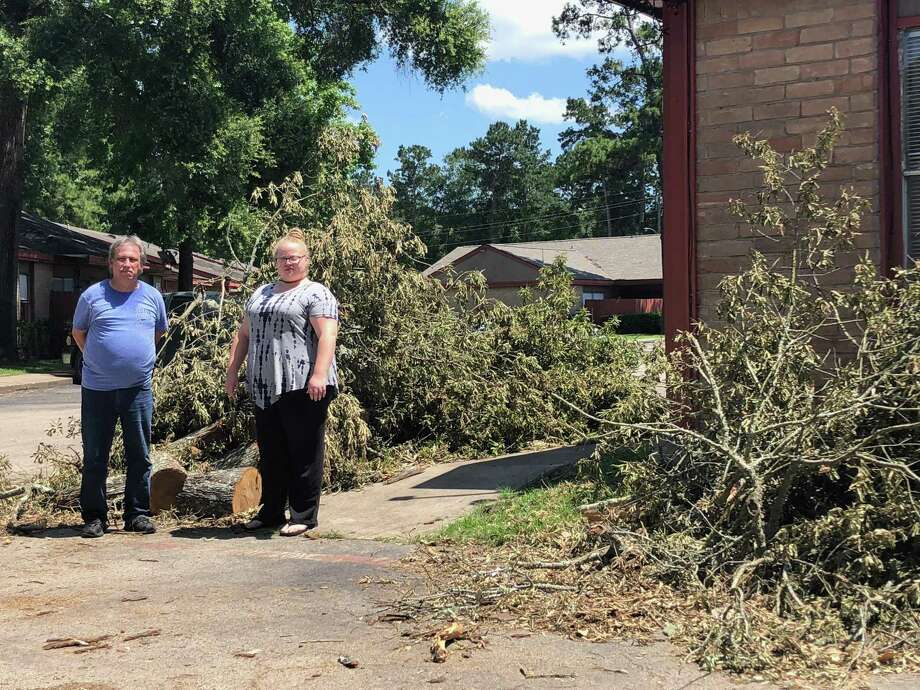 Vernon Reed (left) and Michelle Stripling (right) show the lasting damage of the storm that struck on the night of Thursday May 9 and Friday May 10 that was still at Lakewood Townhomes in Huffman that following Thursday. Photo: Elliott Lapin / Staff Photo