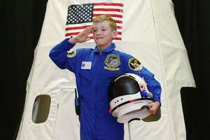Apollo 12 Commander Timmy Hopkins emerges from the capsule during Columbus Magnet School's annual Young Astronauts Mission Landing event Friday at the school in Norwalk. The landing ceremony for their 2019 mission mimicked the two Apollo moon landing missions, 11 and 12.