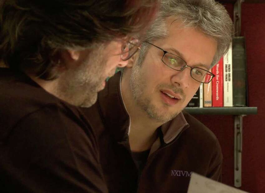 Keith Raniere, left, is pictured with Mark Vicente, right, at Raniere's 8 Hale Drive townhouse in a 2012 video in Halfmoon, N.Y. The video was submitted as evidence in the federal trial of Keith Raniere. (U.S. Government exhibit)