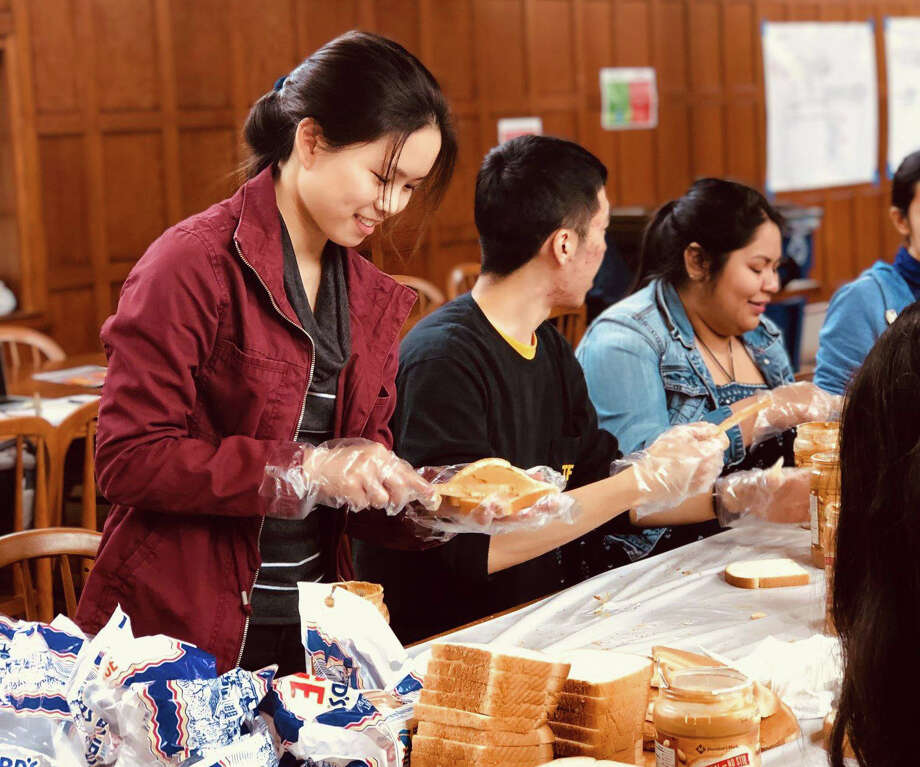 Rice University students prepare peanut butter and jelly sandwiches that they donate to homeless shelters in Houston.