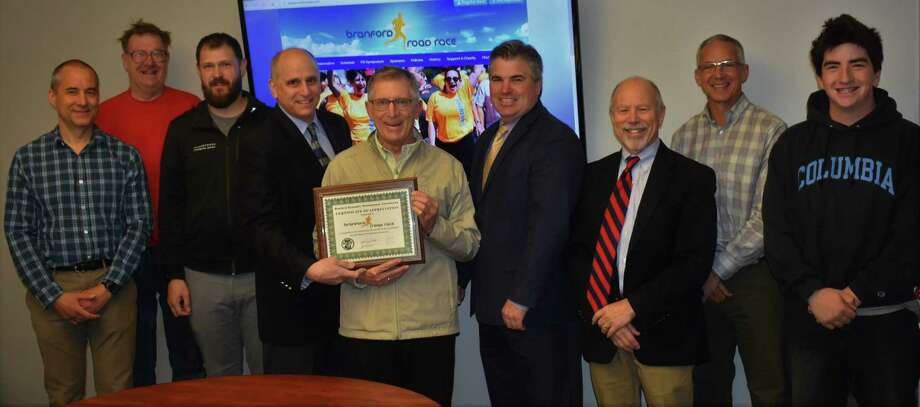The Branford Economic Development Commission recently presented its Business Recognition Award to Branford Road Race founder Ray Figlewski and the race committee. From left, Branford Road Race coordinator John Bysiewicz, Matt Hally, Preston Ranton, EDC Chairman Perry Maresca, race founder Ray Figlewski, Branford First Selectman Jamie Cosgrove, Phil Carloni, Ed Vescovi and Mark Hally. Photo: Bill O'Brien / Contributed Photo