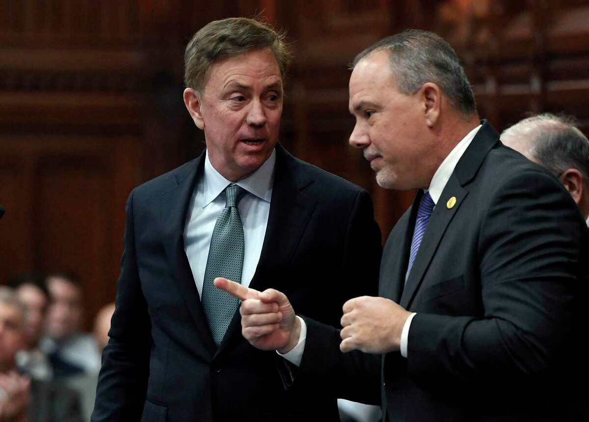 Connecticut Gov. Ned Lamont talks with Speaker of the House Joe Aresimowicz, in a file photo. Both support Joe Biden for president.