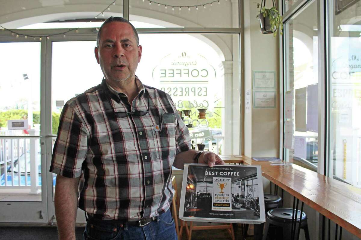 Ed Freedman, owner Shearwater Organic Coffee Roasters, talks about the Fairfield coffee bar's award of Best Coffee by Fairfield Magazine's Readers Choice Awards on display at the bar in Fairfield on May 16, 2019. A new Westport locatoin will open in June.